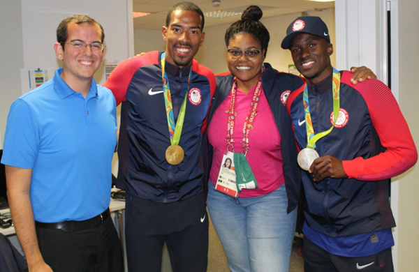 Ted Emrich ('09) at the 2016 Rio Summer Olympics with U.S. men's triple jump gold medalist Christian Taylor, NBC Sports commentator Carol Lewis Zilli, and U.S. men's triple jump silver medalist Will Claye.