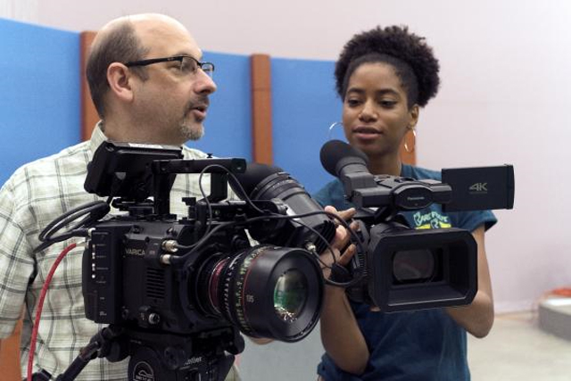 Eugene Martin demonstrates how to use one of the new Panasonic cameras.