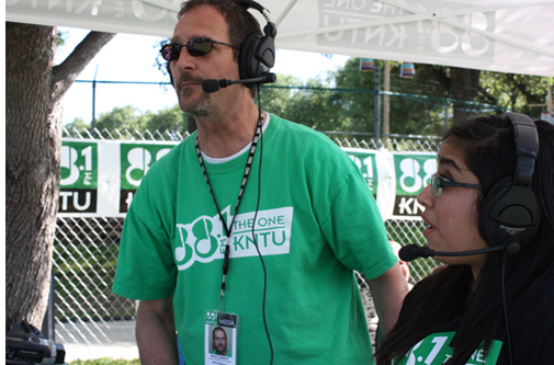 Mark Lambert broadcasting with a student from the 2014 Denton Arts & Jazz Festival.
